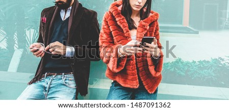 Fashion influencers people using smartphone social media app - Young trendy couple watching story video on mobile cell phone - Technology trends, marketing and new digital job concept - Focus on hands #1487091362