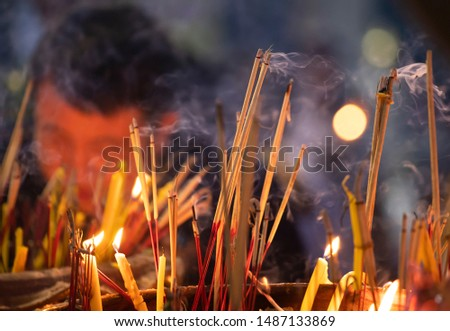 Burning incense and candles at thai buddhis celebration - Visakha Bucha Day #1487133869