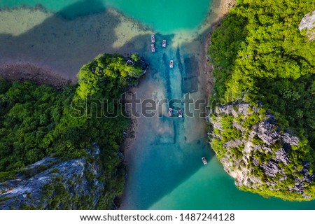 Aerial view Vung Vieng floating fishing village and rock island, Halong Bay, Vietnam, Southeast Asia. UNESCO World Heritage Site. Junk boat cruise to Ha Long Bay. Famous destination of Vietnam Royalty-Free Stock Photo #1487244128