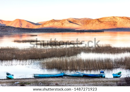 Landscape of Lake Beysehir (Turkish: Beysehir Golu) and fishing boats in Konya provinces, southwestern part of Turkey. It is used for irrigation and aquaculture, although it is also a national park. #1487271923