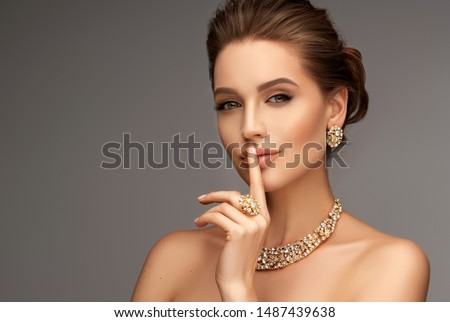Beautiful girl with set jewelry .   Woman in a necklace with a ring, earrings and a bracelet. Beauty and accessories. #1487439638