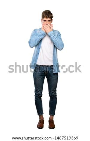 A full-length shot of a Handsome young man covering mouth with hands over isolated white background #1487519369