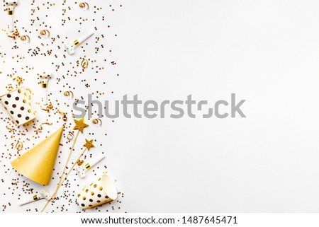 Celebration background - party accessories in golden colors. Copy space. #1487645471
