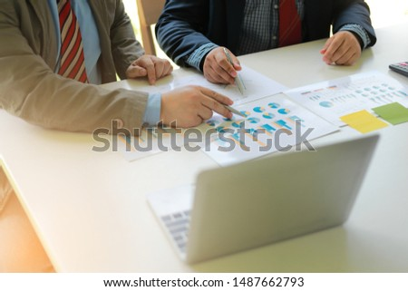 Business mans group working at office with laptop and documents graph on his desk Consultant is explaining solutions to his client #1487662793