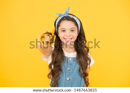 Happy childhood. Bakery confectionery concept. Kid girl hold muffin. Delicious cupcakes. Little child with muffin on yellow background. Treat someone with sweets. Yummy cupcake. Homemade muffin. #1487663825