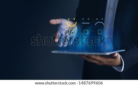 Customer Experiences Concept. Positive Review and Feedback, Businessman in Suit Present Excellent Rating with Smiling icon for a Satisfaction on digital tablet #1487699606