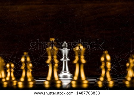 single silver king chess surrounded by a number of gold chess pieces and abstraction connection line network screen, business strategy concept #1487703833