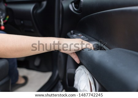 woman closing car and sitting in or driving car,  Auto Business.   #1487742245