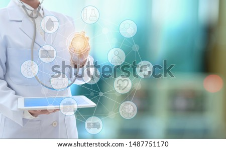 Medical technology network concept. doctor using digital tablet with medical icons and stechoscope at hospital background. #1487751170