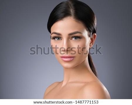 Beautiful woman face healthy skin and hair natural makeup beauty eyes lashes #1487771153