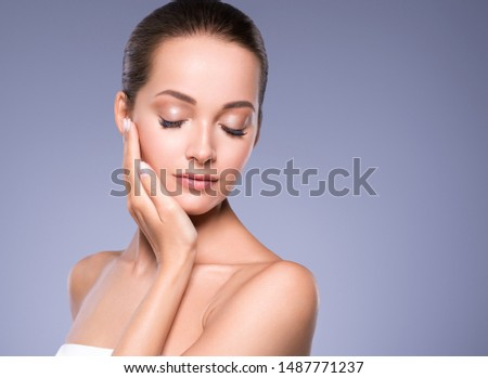 Beautiful woman face healthy skin and hair natural makeup beauty eyes lashes #1487771237