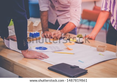 Team of young Architect Designer is brainstorming ideas and plan in office. Start up business people is sharing strategy in co working meeting for Business Success brainstorm concept. #1487819861