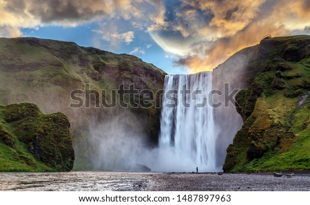 Majestic nature of Iceland. Impressively View on Skogafoss Waterfall with colorful sky glowing sunlight, during sunrise. Skogafoss the most famous place of Iceland. creative artistic image. postcard #1487897963
