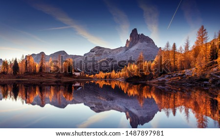 Majestic sunset of the mountains landscape. Wonderful Nature landscape during sunset. Beautiful colored trees over the Federa lake, glowing in sunlight. wonderful picturesque scene. color in nature #1487897981