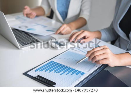 Executive business woman team brainstorming on meeting to conference planning investment project working and strategy of business making conversation with partner, financial and accounting concept. #1487937278