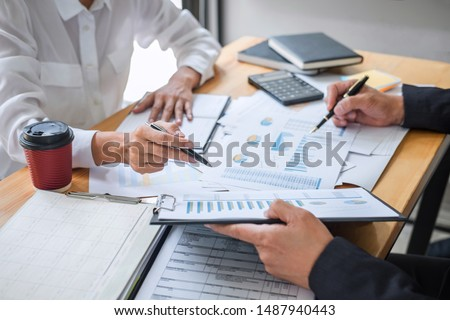 Business team consultant working with new startup growth project plan and discussion analyzing for financial strategy statistics with computer, results of collaboration their successful teamwork. #1487940443