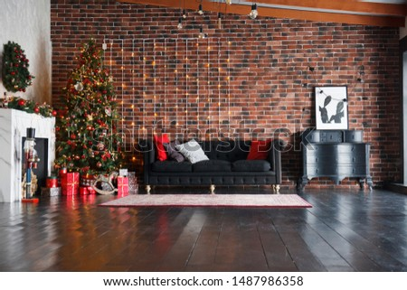 Christmas, xmas, New Year interior with red brick wall background, decorated fir tree with garlands and balls, dark drawer,dark sofa, picture and white fireplace