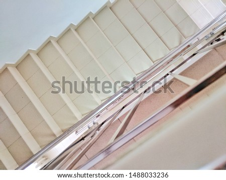 empty stairs and railing inside the building #1488033236
