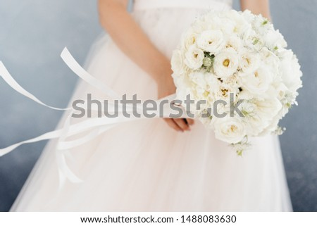 white bride's bouquet in the hands of the bride #1488083630