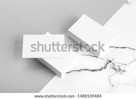 Photo of white business cards on white marble. Template for branding identity isolated on marble background. For graphic designers presentations and portfolios marble premium luxury mock-up.