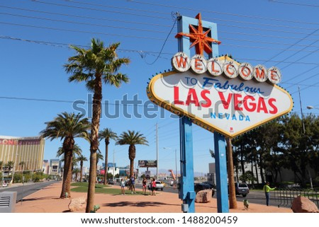 LAS VEGAS, USA - APRIL 14, 2014: People take photos with Welcome to Fabulous Las Vegas Nevada, famous sign. The sign is on National Register of Historic Places. #1488200459