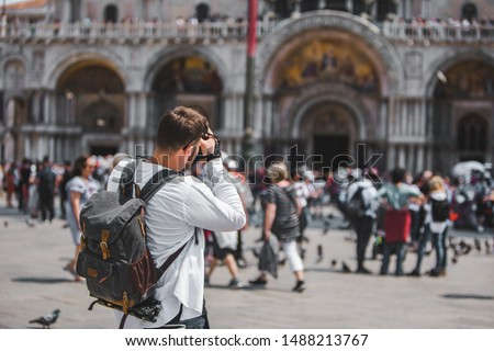 man taking picture of basilica dominated square travel concept