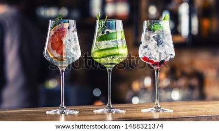 Gin tonic cocktails in wine glasses on bar counter in pup or restaurant.  #1488321374