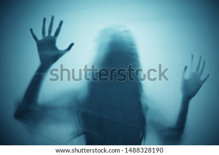 Shadow of scary ghost woman  Royalty-Free Stock Photo #1488328190