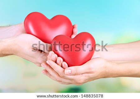 Hearts in hands on nature background #148835078