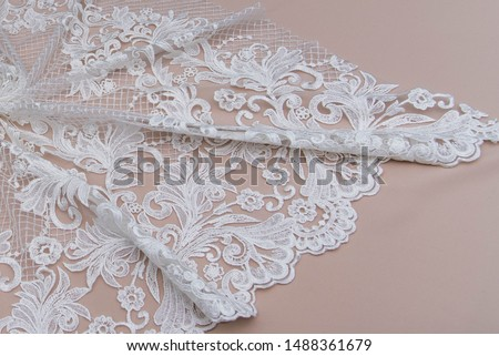 Texture lace fabric. lace on white background studio. thin fabric made of yarn or thread. a background image of ivory-colored lace cloth. White lace on beige background. #1488361679