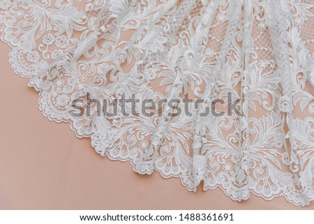 Texture lace fabric. lace on white background studio. thin fabric made of yarn or thread. a background image of ivory-colored lace cloth. White lace on beige background. #1488361691