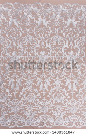 Texture lace fabric. lace on white background studio. thin fabric made of yarn or thread. a background image of ivory-colored lace cloth. White lace on beige background. #1488361847