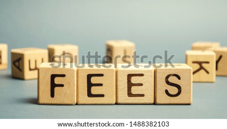 Wooden blocks with the word Fees and randomly scattered cubes. Fixed price charged for a specific service. Business and finance concept. Costs, charges, commissions, penalties. Cost, fee and taxes. #1488382103