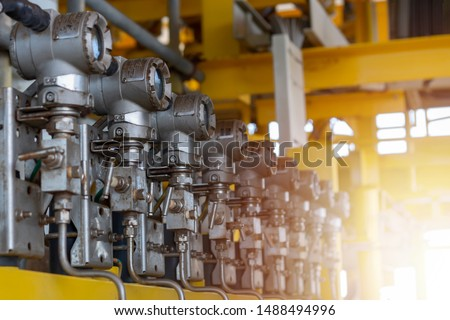 Pressure transmitter install at downstream of choke valve to monitor pressure of flow line that are leak or over pressure to protect piping. Oil and Gas Wellhead Remote Platform. Royalty-Free Stock Photo #1488494996