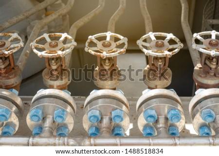 Stainless steel globe valve at bottom of multi stage gas compressor bundle for drain liquid inside turbine compressor chamber.
