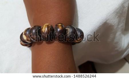 An African, Kenyan, Bone bead wrist band on a wrist  #1488526244