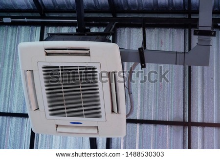 Ceiling mounted cassette type air conditioner hanging on the reception coffee room. #1488530303