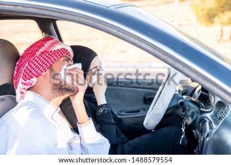 Two arabic people hiding their noses from toxic smoke #1488579554