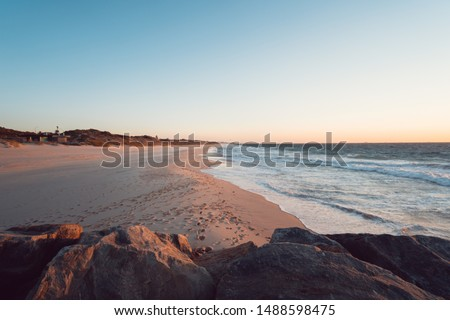 City Beach, Perth, Western Australia at sunset, quiet and empty with a peaceful glow in the background. This beach is a short distance from the city centre and prime location for the evening sunset.  Royalty-Free Stock Photo #1488598475