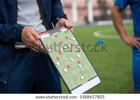 Football tactic education. Coach explains the strategy of the game #1488657803