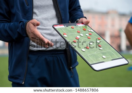 Football tactic education. Coach explains the strategy of the game #1488657806