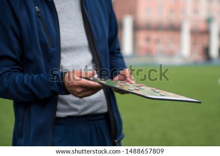Football tactic education. Coach explains the strategy of the game #1488657809