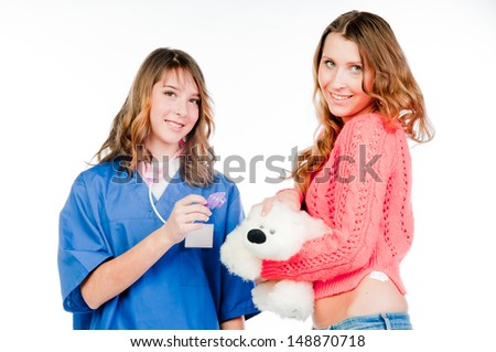 child to the doctor in blue robe #148870718