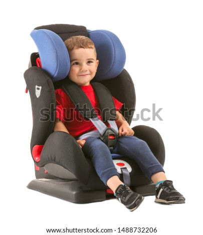 Little boy buckled in car seat on white background #1488732206
