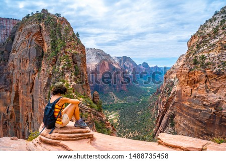 A young woman on top of the trekking of the Angels Landing Trail in Zion National Park, Utah. United States #1488735458