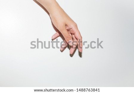 White background with posed female hand portraying communicative body language through simplicity. Talking hands #1488763841
