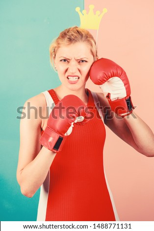 VIP gym. Fighting queen. Woman boxing glove and crown symbol of princess. Queen of sport. Become best in boxing sport. Feminine tender blonde with queen crown wear boxing gloves. Fight for success. #1488771131