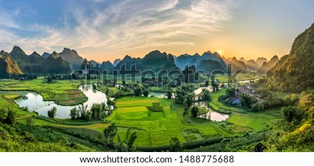 Rice terrace paddle field in sunset and dawn at Phong Nam, Trung Khanh, Cao Bang, Vietnam. Cao Bang is beautiful in nature place in Vietnam, Southeast Asia. Travel concept Royalty-Free Stock Photo #1488775688