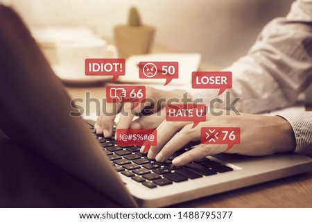 cyber bullying concept. people using notebook computer laptop for social media interactions with notification icons of hate speech and mean comment in social network #1488795377