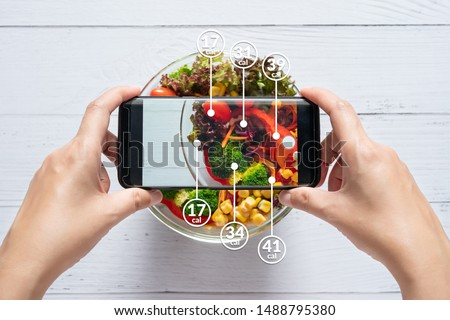 Calories counting and food control concept. woman using application on smartphone for scanning the amount of calories in the food before eat #1488795380